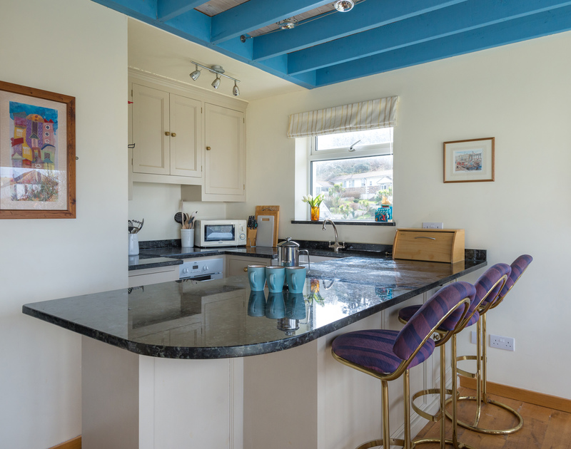 Compact kitchen with a good sized breakfast bar at self catering, holiday house to rent Beachside in Polzeath.