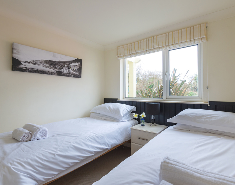Stylish twin bedroom at Beachside, a self catering holiday rental situated in the middle of Polzeath, a stones throw from the beach.