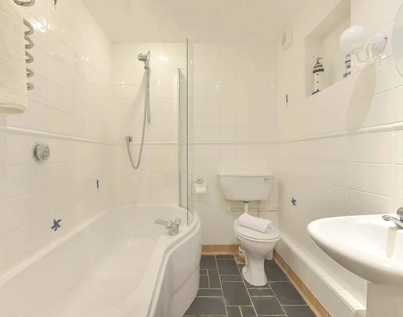 One of the three smart bathrooms in Slipway 19, a self catering holiday cottage to rent in Rock, Cornwall.
