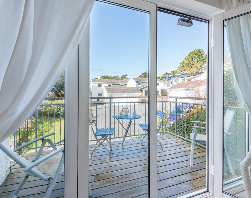French doors open out onto a decked balcony at Slipway 19, a self catering holiday rental in Rock.