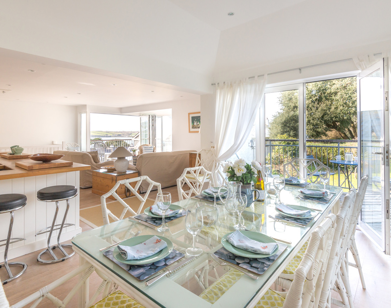 The elegantly furnished open plan kitchen/dining and sitting room in Slipway 19, a self catering holiday cottage to rent in Rock, North Cornwall.