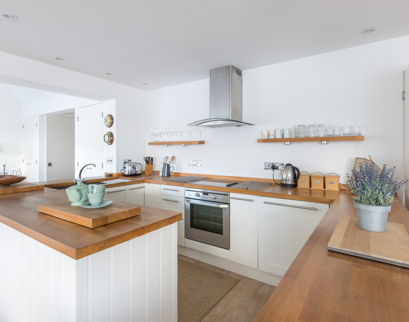 The attractive, well equipped kitchen in Slipway 19, a self catering holiday cottage to rent in Rock, North Cornwall.