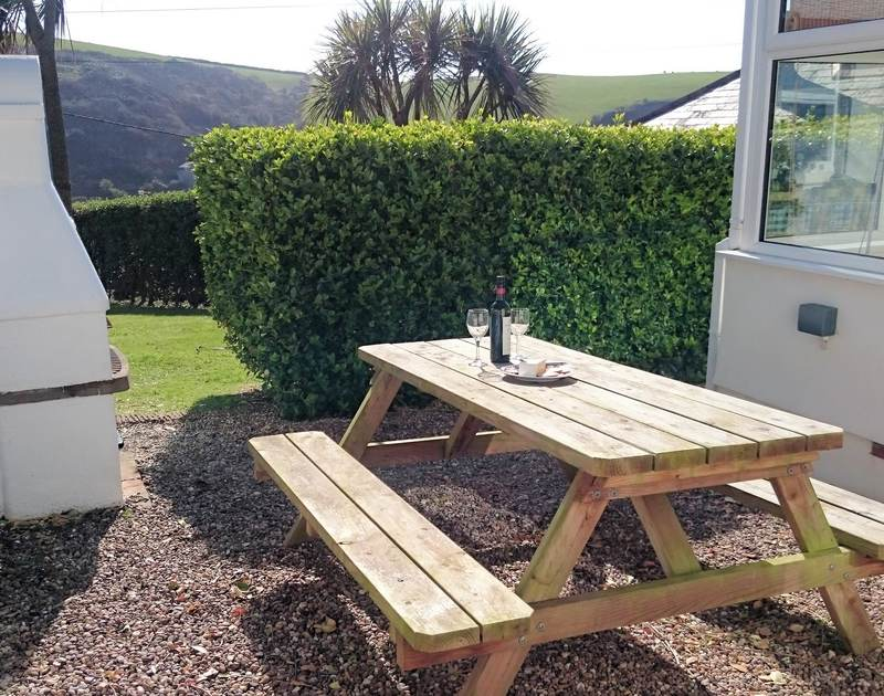 The sunny sheltered patio table at the self catering 2 bedroom holiday rental, Tamarisk in the lovely Port Isaac, North Cornwall.