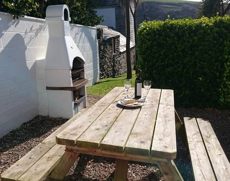 Lunch in the sunshine at the sheltered patio table at the self catering 2 bedroom holiday rental, Tamarisk in the lovely Port Isaac, North Cornwall.