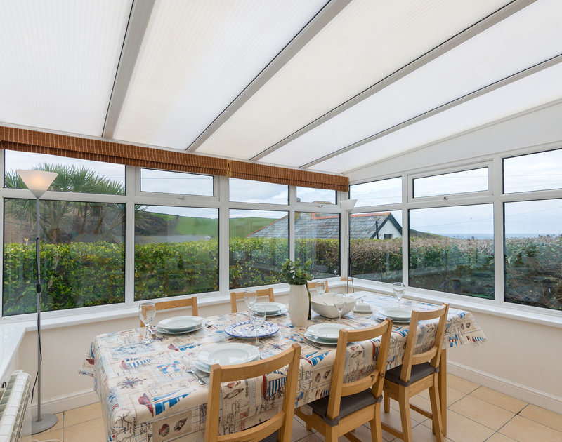 The dining room at Tamarisk has space and views over the sea on the North Coast of Cornwall in Port Isaac.