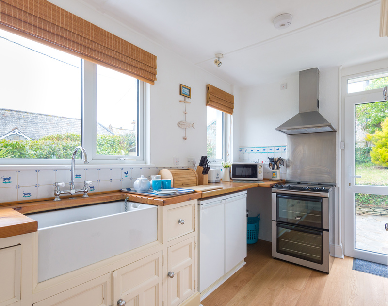 The kitchen at Tamarisk benefits from plenty of natural light and  has sea views over the North Cornish Coast at Port Isaac.