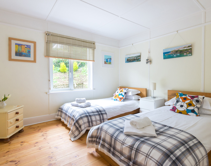 The bright and cheery twin bedroom at Tamarisk, a delightful, south facing detached holiday bungalow in Port Isaac.
