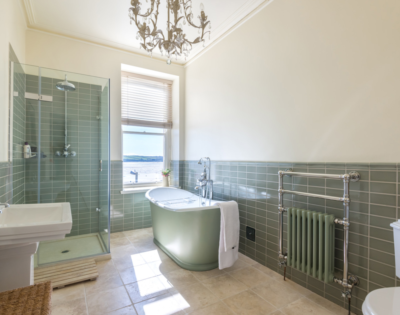 Luxurious bathroom with freestanding bath and wonderful sea views out across the Camel Estuary at 5, The Terrace in Rock.