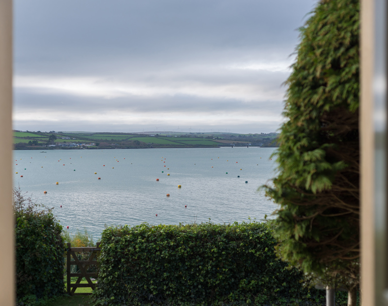 The garden gate, just across the road with the boat moorings bobbing on the Camel Estuary beyond at 5, The Terrace in Rock.