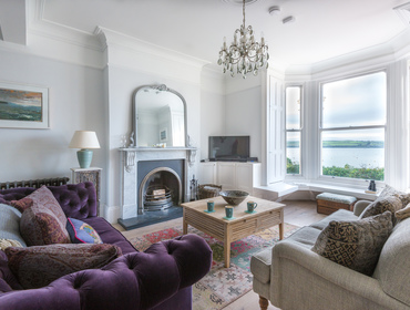 The elegant sitting room with Victorian features and fabulous Camel Estuary views at  5, The Terrace in Rock, north Cornwall.