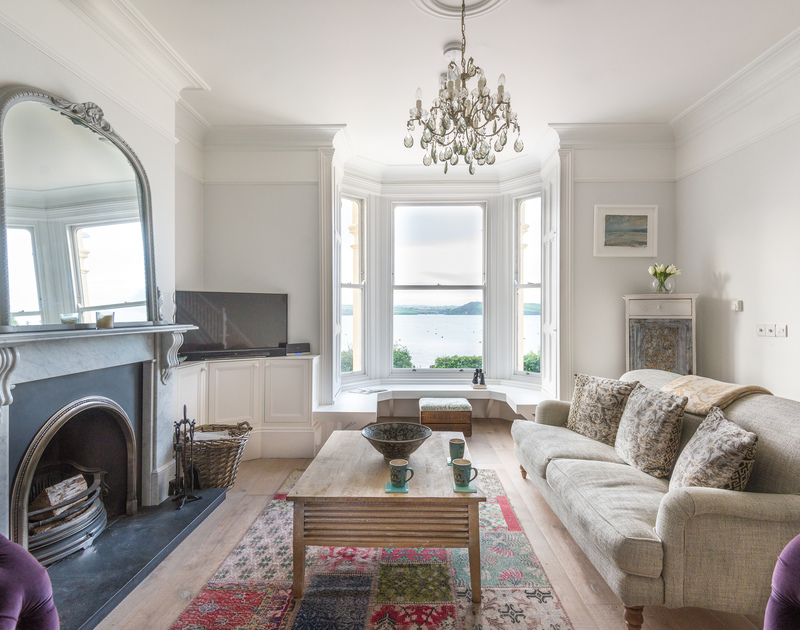 A living room with a view - gorgeous interior and stunning exterior at 5, The Terrace, an enviable holiday house in Rock, Cornwall.