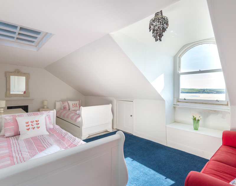 Gorgeous twin bedroom on the second floor with fabulous views over the Camel Estuary through the pretty windows at  5, The Terrace in Rock.