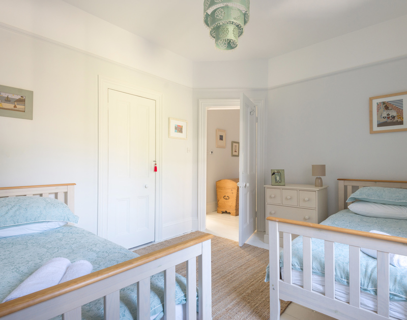 The twin bedroom on the first floor at 5, The Terrace in Rock, Cornwall.