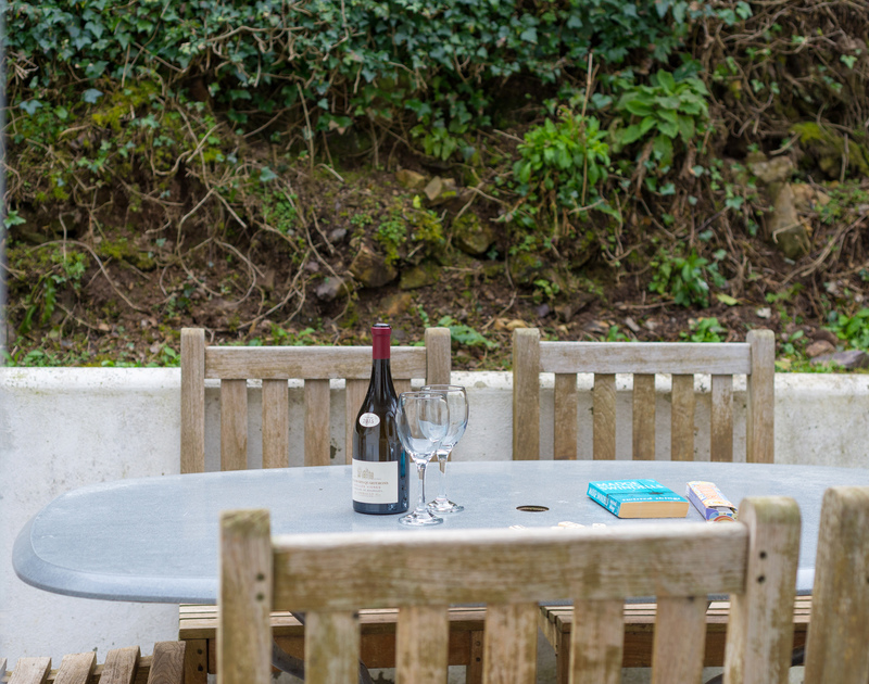 Enjoy a sit down and a glass or two outside at Beaches a seaside holiday property to rent within walking distance of Polzeath Beach.
