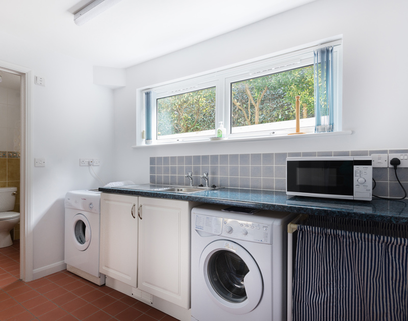 Useful utility room with WC at self catering holiday house Beaches available to rent in Polzeath, North Cornwall.