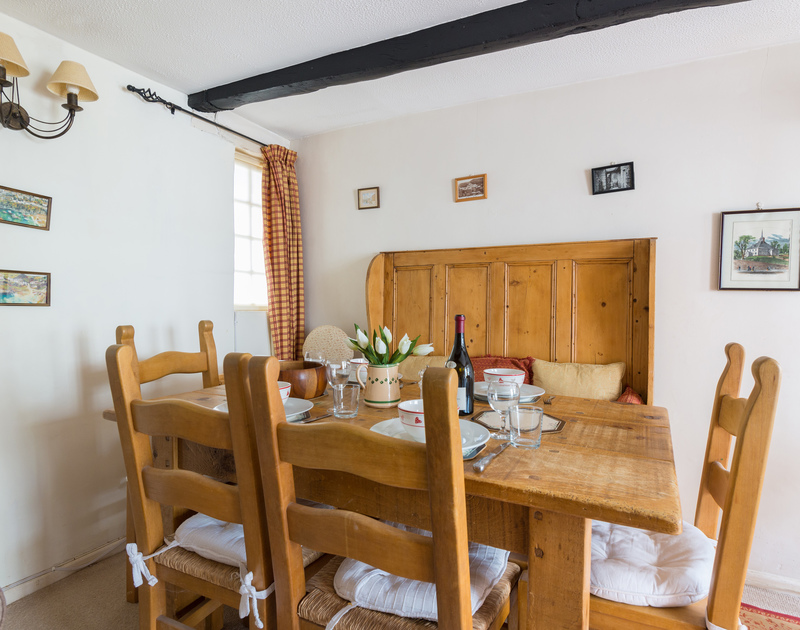 The dining table at characterful self catering holiday rental Temple Cottage, set within the heart of the village of Port Isaac in North Cornwall.