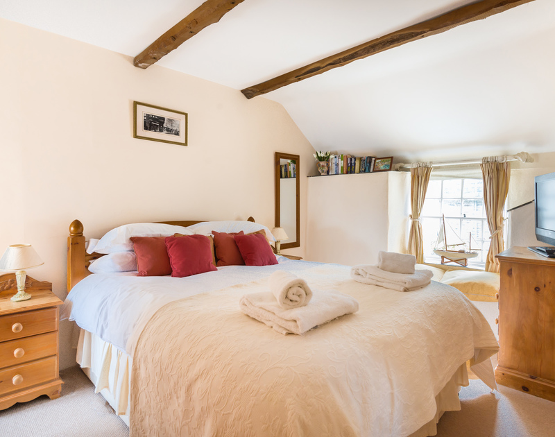 The double bedroom with exposed beams at Temple Cottage, self catering holiday accommodation in Port Isaac in North Cornwall.