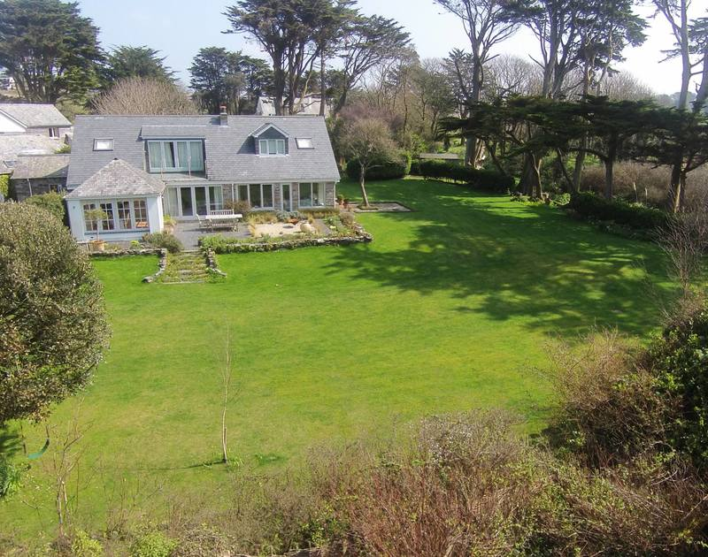 The front garden and house of Greystones, a stunning holiday house to rent at Daymer Bay, Cornwall, in easy walking distance of the beach.