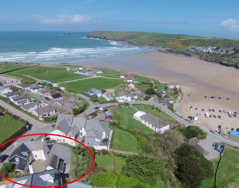 An aerial view of Ivy Cottage with its sunny terrace, excellent position to the beach, Ivy is a holiday rental in Polzeath, North Cornwall
