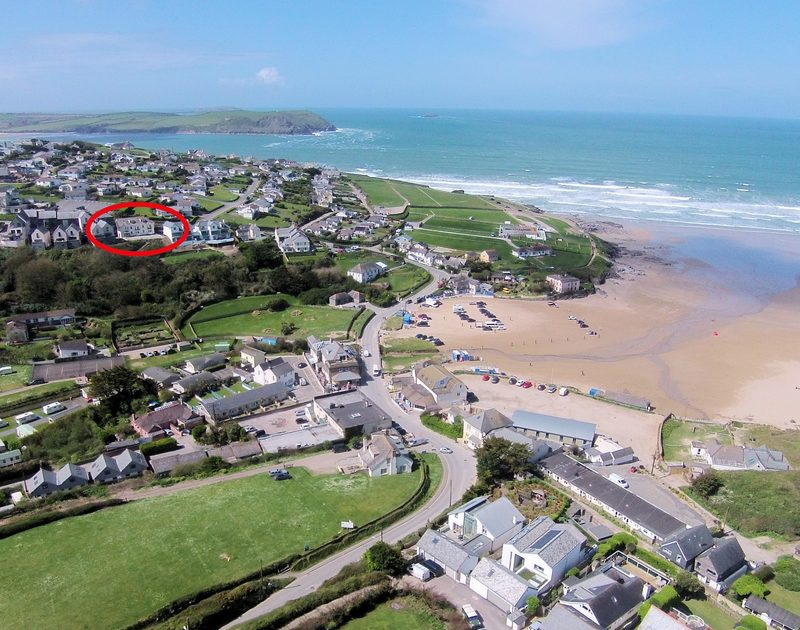 An aerial view of 5, Pinewood Flat, a holiday rental, North Cornwall that is in very close proximity to the surf beach of Polzeath