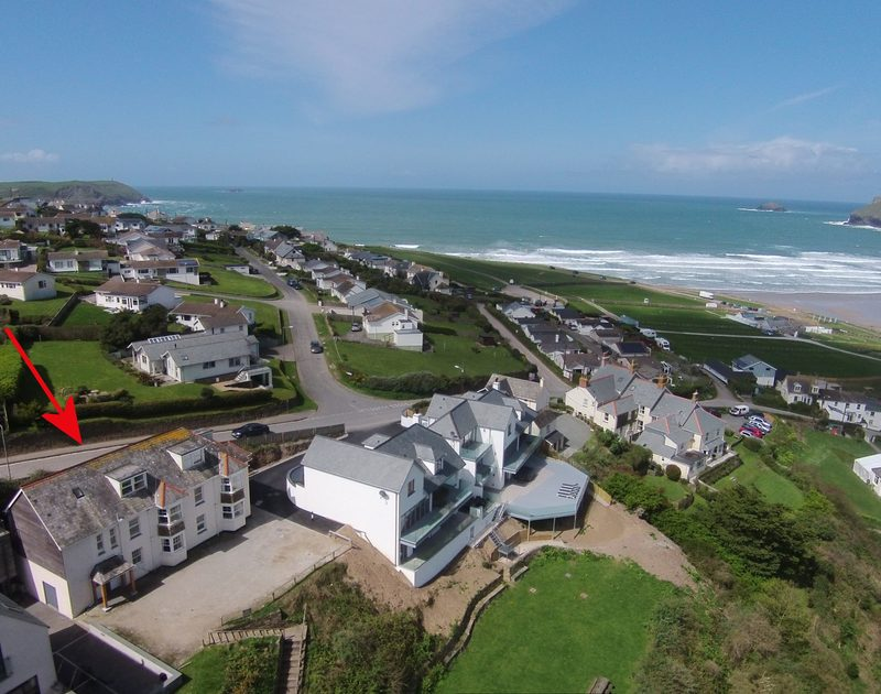 An close in aerial view of 5, Pinewood Flat, which is walking distance from the surf and available for holiday rental in Polzeath, Cornwall.