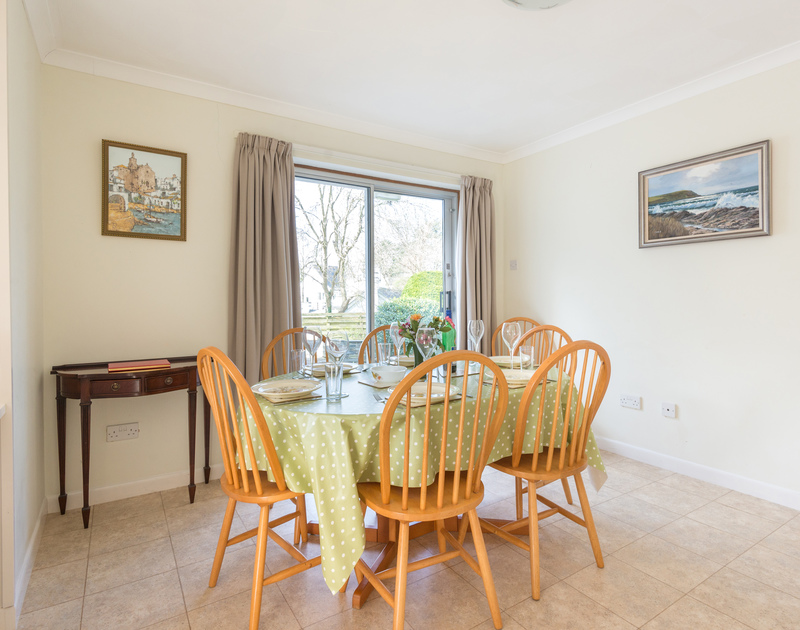 The bright, light dining room at Bahari, a self catering holiday house to rent in popular Rock near the Camel Estuary in Cornwall.