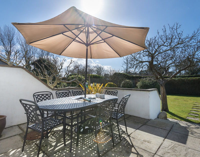 Enjoy family meals or get togethers in the garden on the paved terrace at The Garden House in Rock, Cornwall.
