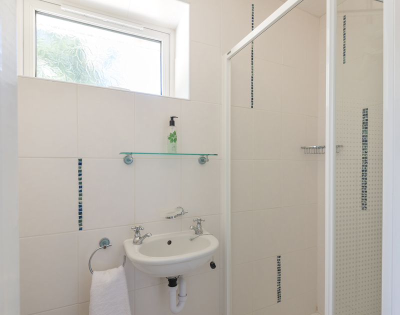 A shower room at The Garden House, a self catering, holiday property to rent in Rock, North Cornwall.