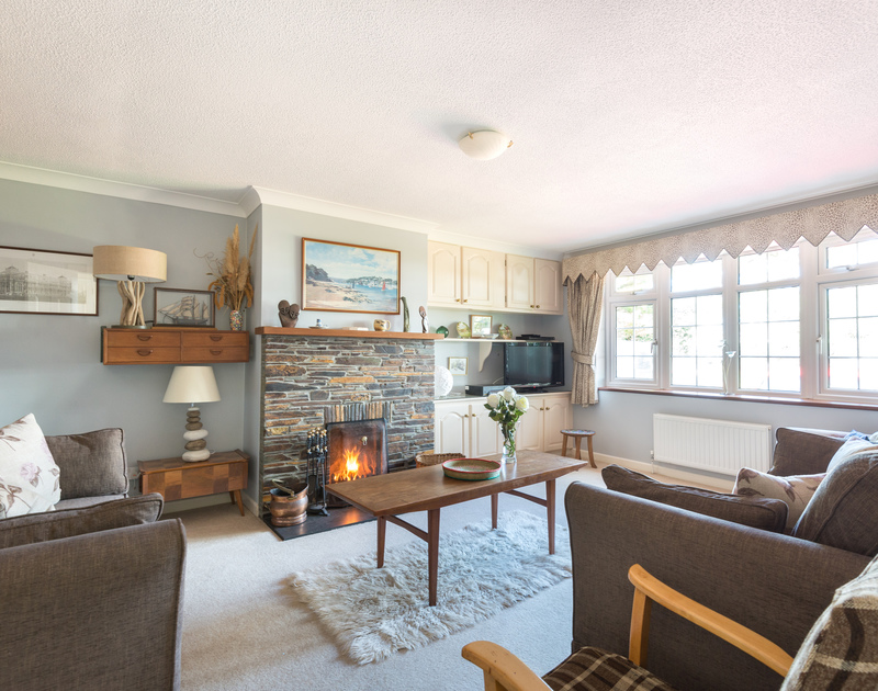 The comfortable sitting room in The Garden House, a self catering holiday rental in Rock, Cornwall.