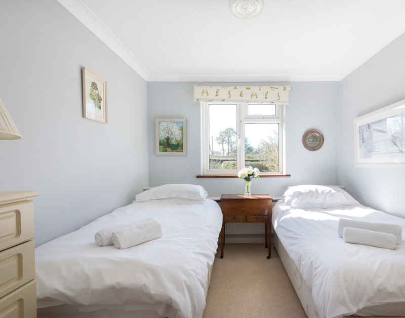 Pretty twin bedroom at The Garden House, a self catering, holiday house to rent in Rock.