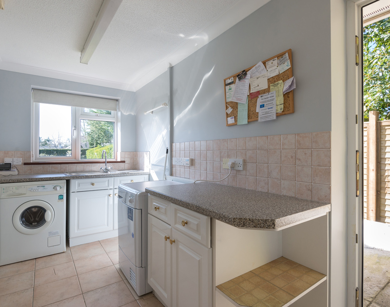 Useful utility room with external door at self catering holiday rental The Garden House in Rock, Cornwall.