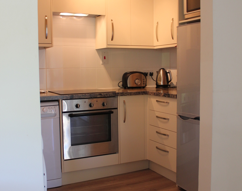 The efficient kitchen of Westward 7, a self-catering holiday apartment to rent in Polzeath, Cornwall