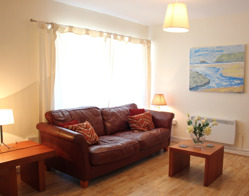 The sitting room of Westward 7, a self-catering apartment in Polzeath, Cornwall
