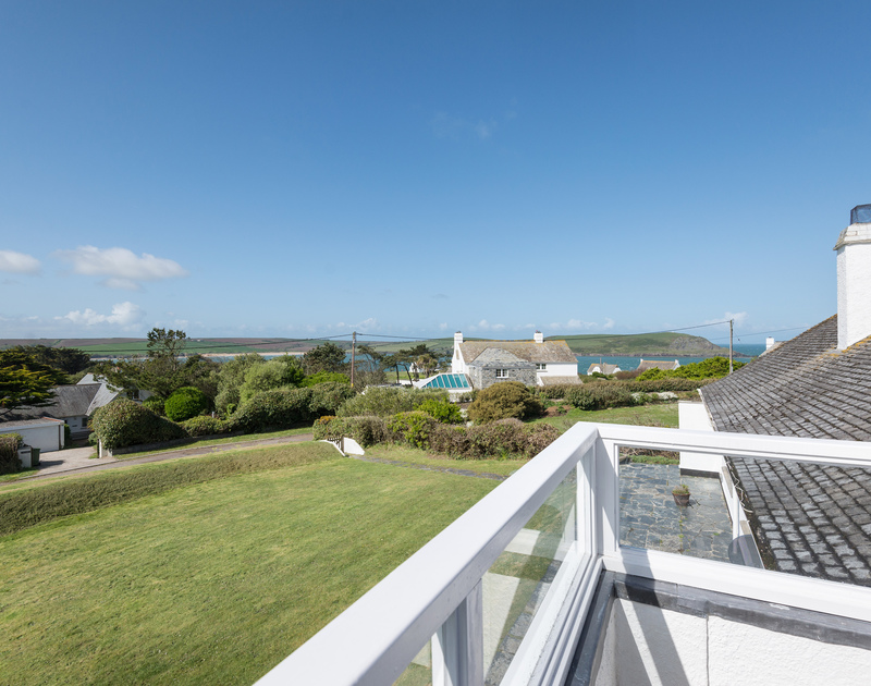 Check on the children playing on the level lawned garden below or look out to sea or Stepper Point from the balcony at Dolphins, close to Daymer Bay and Polzeath.