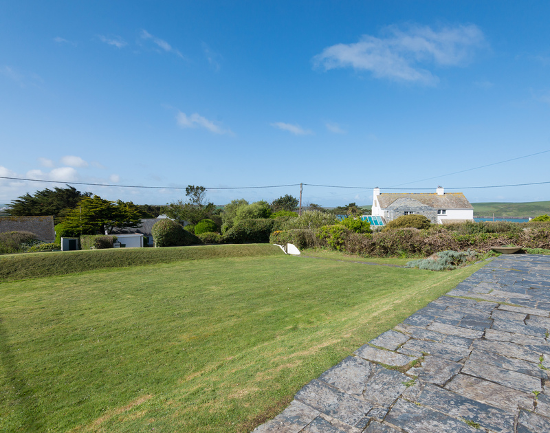 Space for garden games and a slate terrace for soaking up the sun at self catering Dolphins, a family holiday property above Daymer Bay.