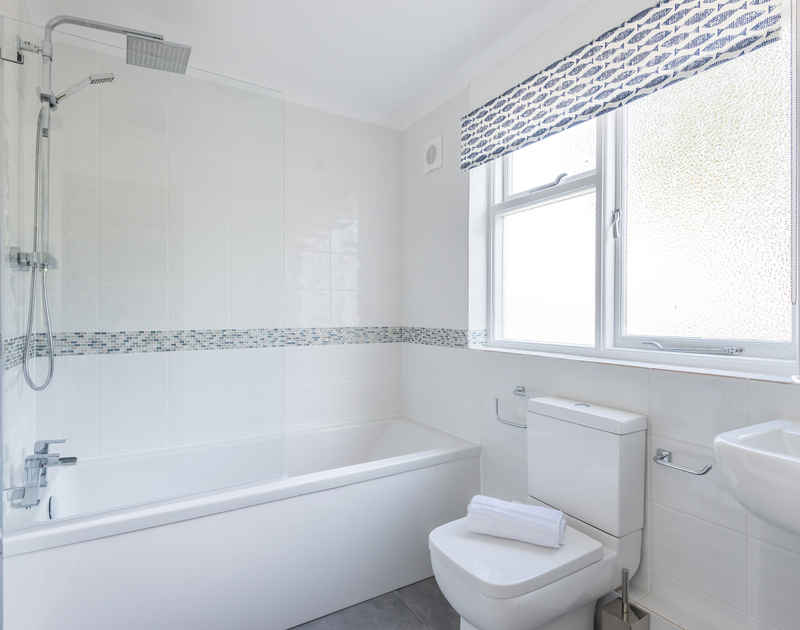 The second of the two family bathrooms with overhead shower at self catering holiday property Dolphins.