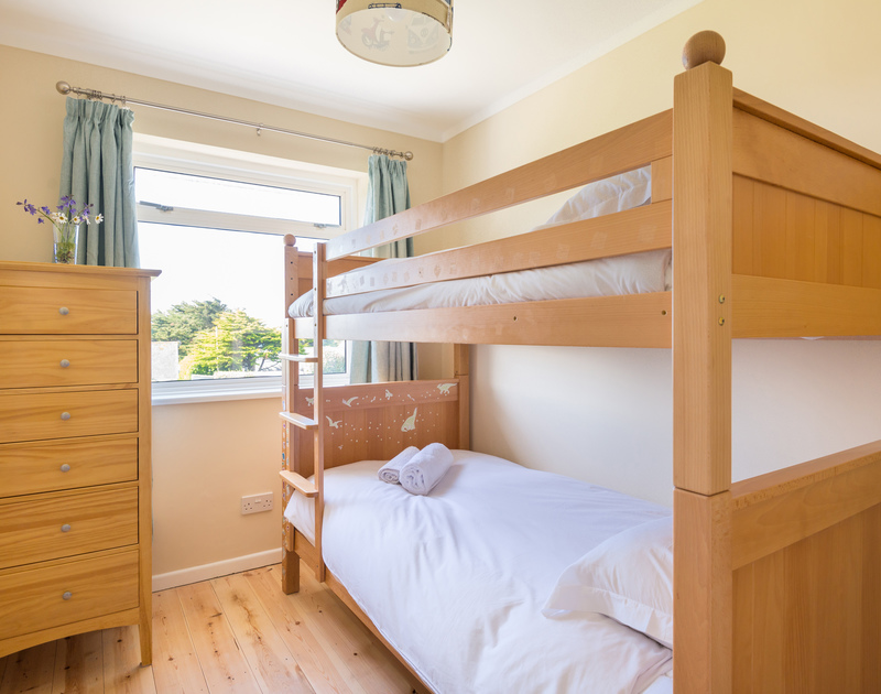 The bunk bedroom at self catering holiday property Dolphins set above Daymer Bay.