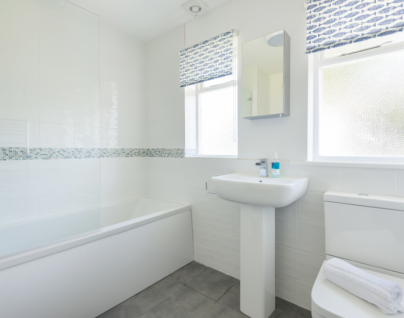 One of two bathrooms with overhead shower at Dolphins, between Daymer Bay and Polzeath.