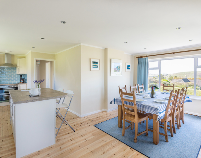 Light, open plan kitchen/dining room at self catering holiday house Dolphins, located between Daymer Bay and Polzeath.