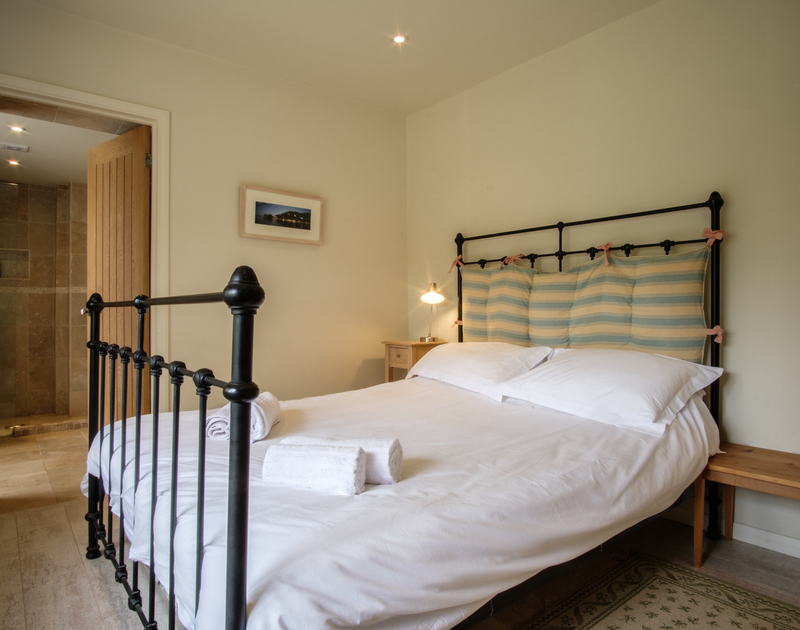 The ground floor double bedroom is stylishly furnished and decorated with an ensuite shower room at Greystones, Daymer bay, Cornwall.