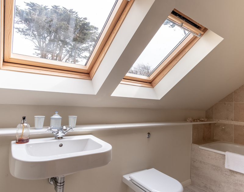 Skylights fill one of the two king size bedroom ensuite bathrooms with plenty of light at Greystones.
