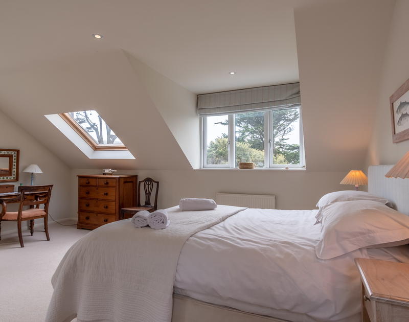 Relaxing bedroom at self catering holiday house Greystones with plenty of light coming in from the windows and skylight.
