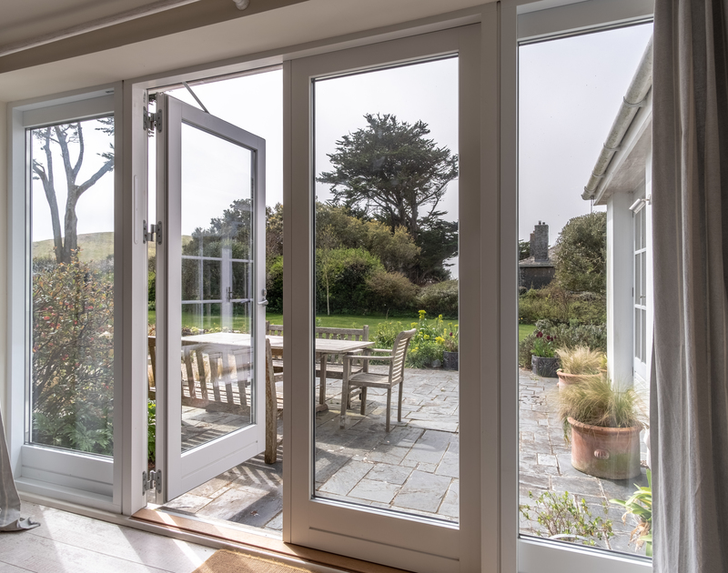 glass patio doors leading out to the garden and patio dining area at Greystones in Daymer Bay North Cornwall