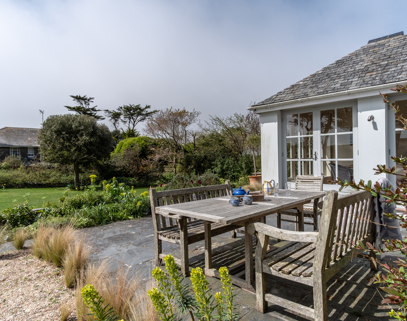 outside dining on the paved patio leading onto the garden at Greystones in Daymer Bay