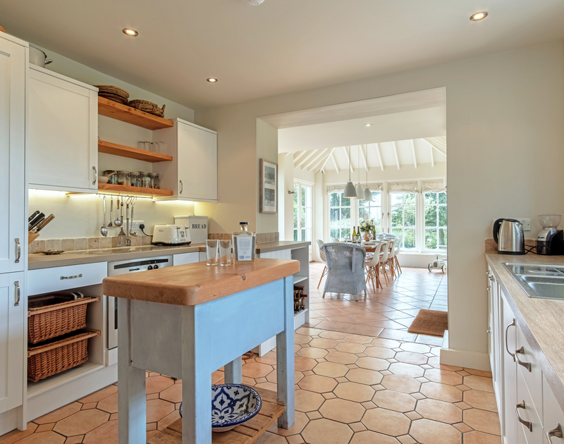 Enjoy preparing and eating family meals together in the open plan kitchen at Greystones in Daymer Bay, Cornwall