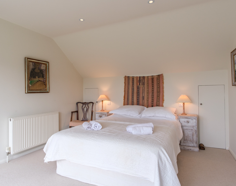One of the five bright, comfortable bedrooms at Greystones, a self catering holiday house close to the beach at Daymer Bay.