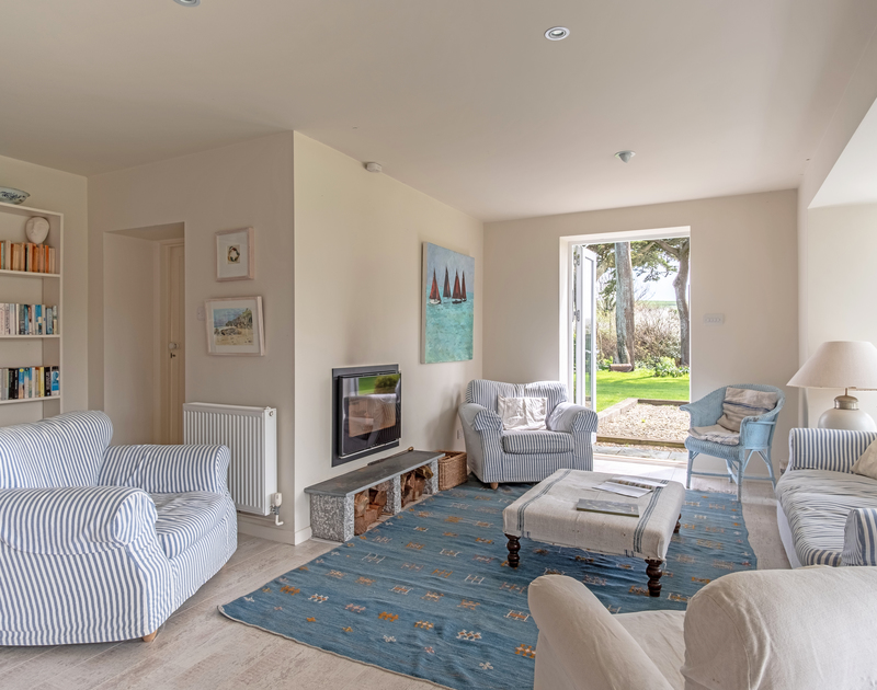 light sitting room with a patio door leading to the garden at Greystones in Daymer Bay