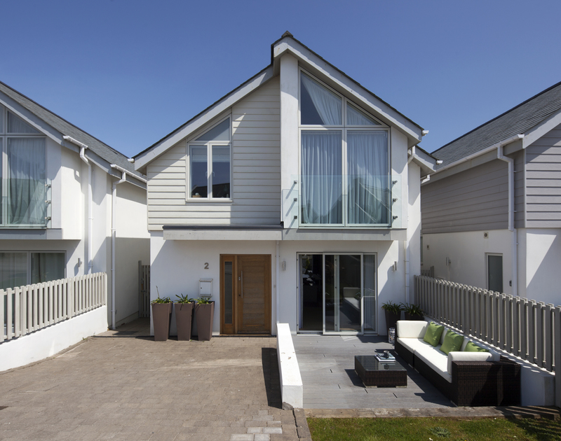 Private parking for two cars and outdoor furniture at 2, The Sands, a luxurious holiday house to rent in Polzeath on the north Cornish coast.