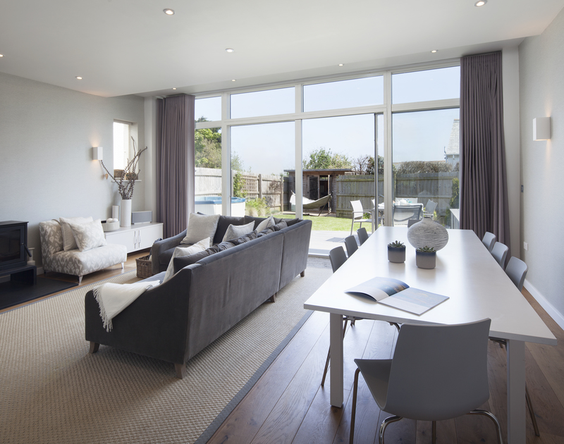Light filled open plan living room with sliding glass doors out to the garden at 2, The Sands in Polzeath, Cornwall.