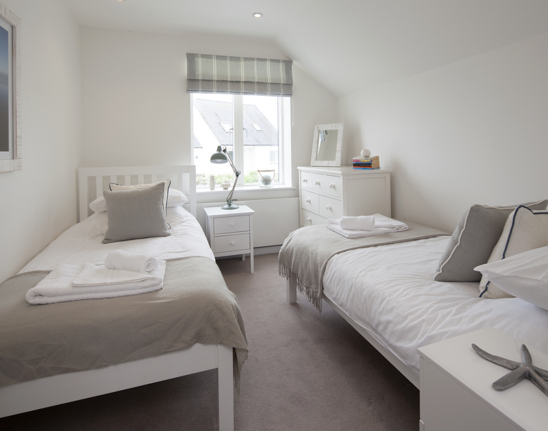 Gorgeous chic designed twin bedroom in 2 The Sands, a luxury self catering holiday home in Polzeath, Cornwall.